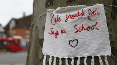 A sign reads 'Girls Should Feel Safe at School' outside a school in Hampstead