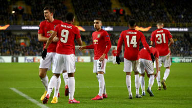 Manchester United players congratulate Anthony Martial on his goal against Club Bruges