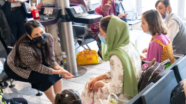 Priti Patel greets Afghan refugees at Heathrow Airport