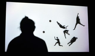 Woman views a video by Duncan Campbell entitled Sigmar 2008 during 2014 Turner Prize press preview
