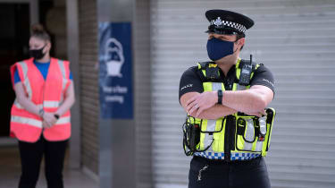 A police officer wearing a mask