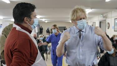 Boris Johnson visits a COVID-19 vaccination centre in Batley