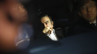 Bloomberg Best of the Year 2019: Carlos Ghosn, former chairman of Nissan Motor Co., center, sits in a vehicle as he leaves his lawyer's office in Tokyo, Japan, on Wednesday, March 6, 2019. Ph