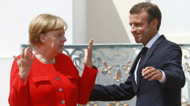 German chancellor Angela Merkel greets French president Emmanuel Macron