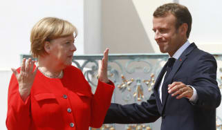 German chancellor Angela Merkel greets French president Emmanuel Macron