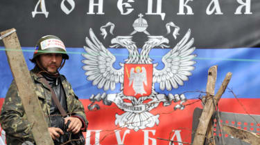 A pro-Russia activist stands guard in the city of Slavyansk