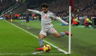Liverpool striker Mohamed Salah takes a corner against West Ham