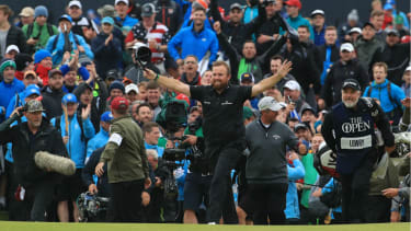 Ireland's Shane Lowry celebrates on the 18th green at 148th Open Championship