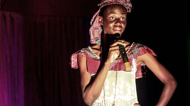 A Congolese pageant contestant talks to the judges