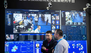 Visitors are filmed by AI (Artificial Inteligence) security cameras using facial recognition technology at the 14th China International Exhibition on Public Safety and Security at the China I