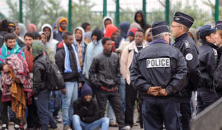 Migrants being detained at Calais