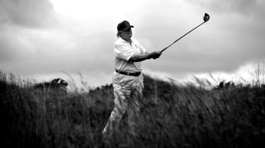 US tycoon Donald Trump plays a stroke as he officially opens his new multi-million pound Trump International Golf Links course in Aberdeenshire, Scotland, on July 10, 2012. Work on the course