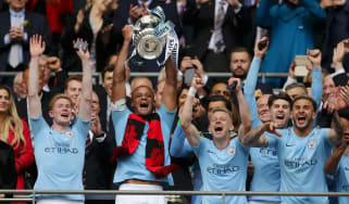 Man City captain Vincent Kompany lifts the FA Cup after the 6-0 win against Watford in the final