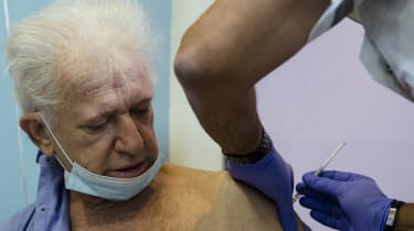 A man receives his Covid vaccine in an Israeli care home.