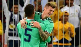 Toni Kroos celebrates his goal with Real Madrid team-mate Raphael Varane