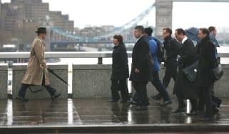 City workers crossing London Bridge