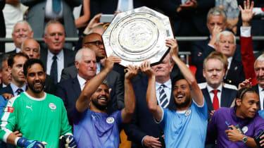 Manchester City's Sergio Aguero and David Silva lift the FA Community Shield at Wembley