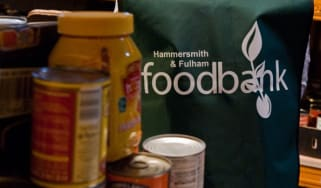 A volunteer sorts through donations at a Food Bank in London