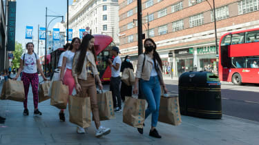 Customers leave the Primark store on Oxford Street, London, in June 2020