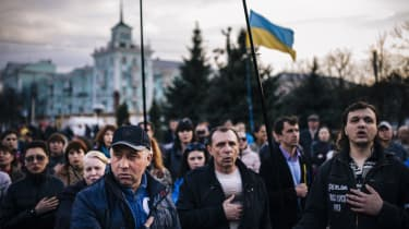 People sing the Ukrainian national anthemduring a pro-Ukraine rally in the eastern Ukrainian city of Lugansk on April 15, 2014. Russia's foreign minister on April 15 warned Kiev against using