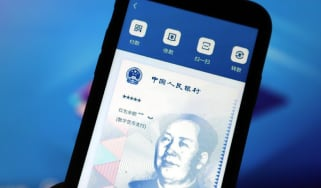 Digital Chinese currency is displayed on a mobile phone in Yichang, Hubei province, China