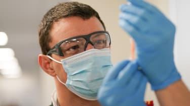 A paramedic draws up the AstraZeneca/Oxford University