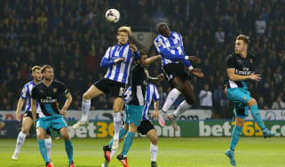Lucas Joao of Sheffield Wednesday rises above the Arsenal defence