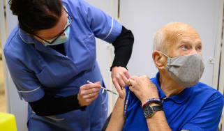 An elderly man receives his Covid vaccination in Surrey.