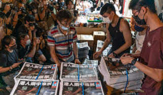 The final issue of Apple Daily is delivered to a newspaper stands