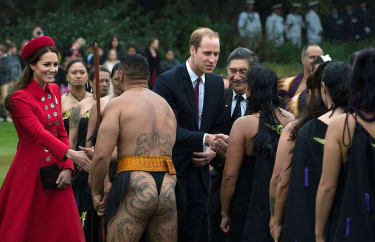 Britain's Prince William (C) and his wife Catherine (L) meet a Maori performance group during a welcoming ceremony at Government House in Wellington on April 7, 2014.Britain's Prince William,