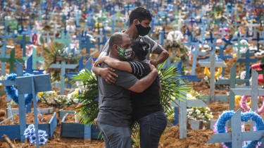 Residents in Manaus attend a mass burial during Brazil's first wave