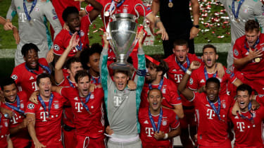 Bayern Munich captain Manuel Neuer lifts the Uefa Champions League trophy