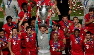 Bayern Munich captain Manuel Neuer lifts the Uefa Champions League trophy
