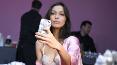 US model Bella Hadid poses for a selfie while getting ready backstage for the Victoria's Secret fashion show