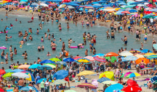 Sunbathers in Benidorm, Spain, before the Covid-19 outbreak