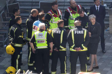 LONDON, ENGLAND - JUNE 15:Prime Minister Theresa May speaks to Dany Cotton, Commissioner of the London Fire Brigade, with members of the fire service as she visits Grenfell Tower, on June 15,