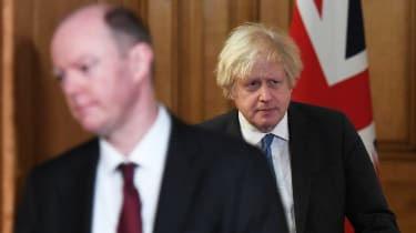 Boris Johnson and Chief Medical Officer Chris Whitty arrive for a Covid-19 media briefing
