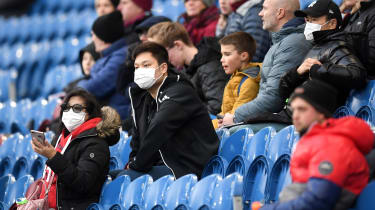 Football fans in facemasks at Turf Moor, home of Burnley