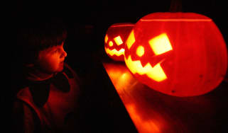 LONDON - OCTOBER 31:A child enjoys traditional candle-lit Halloween pumpkins on October 31, 2007 in London.(Photo by Peter Macdiarmid/Getty Images)