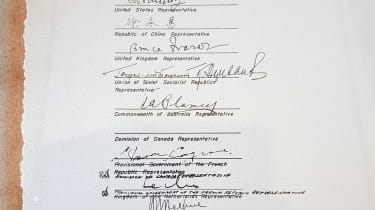 Canada's representative signed the document in the wrong place, leading to some hasty crossings-out
