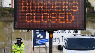 A sign informs drivers that the French border crossing is closed.