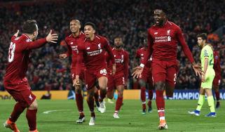 Liverpool's Divock Origi (right) celebrates scoring the fourth goal against Barcelona at Anfield