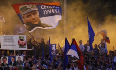 Serb ultra-nationalists wave flags showing Mladic at a rally in 2011