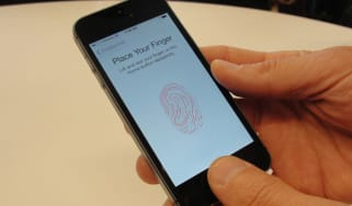 New iPhone 5S handsets let people use their fingerprints to unlock the smartphones at an iPhone event at Apple's headquarters in Silicon Valley on September 10, 2013 in Cupertino, California.