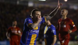 Shrewsbury Town's Jason Cummings celebrates his first goal against Liverpool
