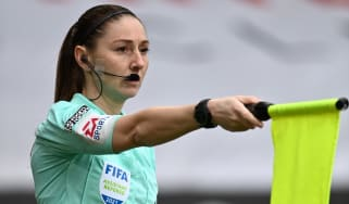 Assistant referee Sian Massey-Ellis flags for offside in a Premier League match