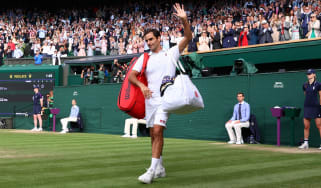 Roger Federer waves to the crowd after losing in the Wimbledon quarter-final against Hubert Hurkacz