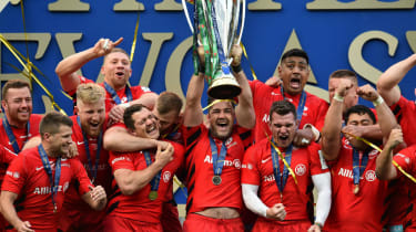 Saracens players celebrate their European rugby Champions Cup victory over Leinster in May