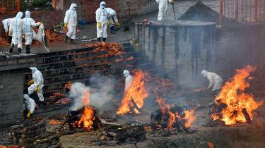 Crematorium workers wearing PPE in Kathmandu, Nepal
