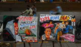 Tributes to the victims of the 26 August suicide bombing at Kabul airport, displayed on a street in Mumbai